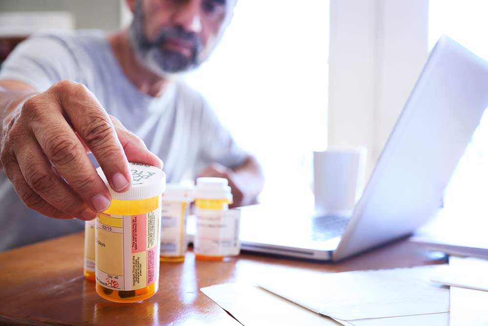 Man taking prescription pills